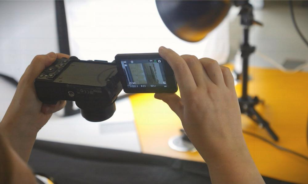 Woman uses a digital camera